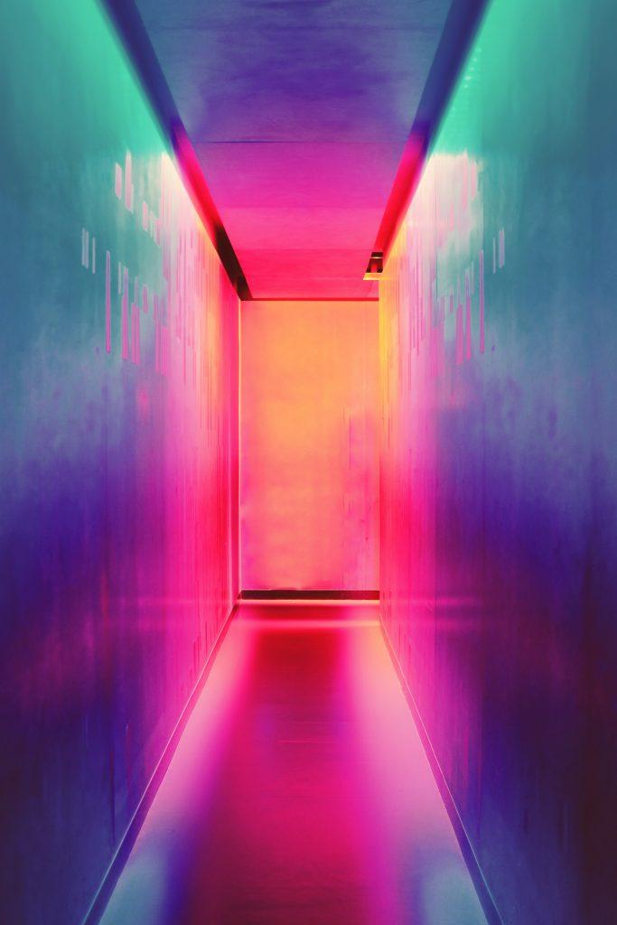 photo of neon lit corridor. Image source: unsplash